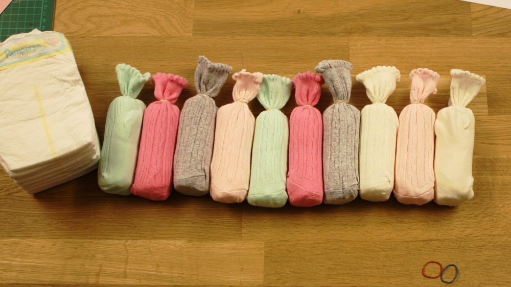 Windelrollen in Babysocken